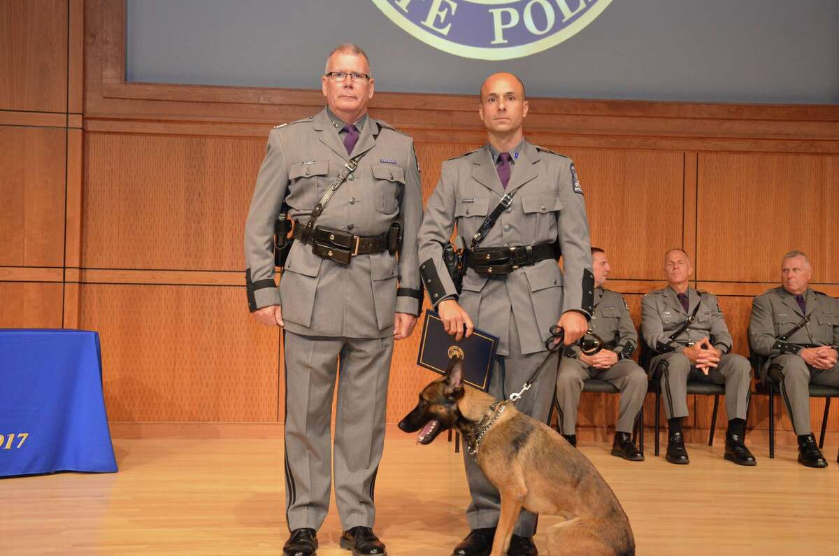 State Police Superintendent George P. Beach II, left, poses with Trooper Ulysses V. Matsoukas and his new canine partner, Dobbs, during a graduation ceremony on Aug. 7, 2018, in Albany, N.Y. The pair will serve Troop K in the Hudson Valley. Dobbs is named after Trooper William F. Dobbs Jr. The 30-year-old was critically injured on Aug. 27, 1939, while his motorcycle crashed on the Taconic Parkway in LaGrange, Dutchess County. Dobbs was thrown from his motorcycle after hitting a car that had crashed into the guardrail and was wedged diagonally across the roadway. He later died of internal injuries. He had worked for the State Police for one year.