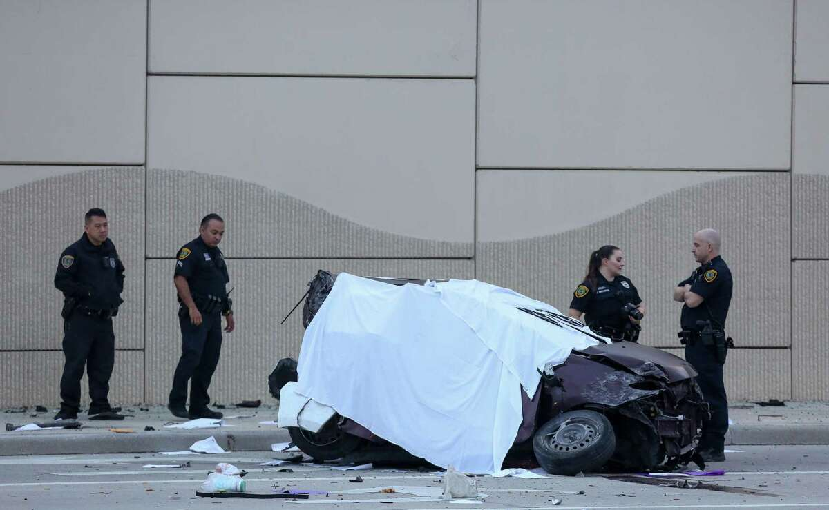 Houston Police officers investigate the scene of a fatal vehicle crash on the Gulf Freeway southbound feeder road near El Dorado Boulevard in Friendswood.