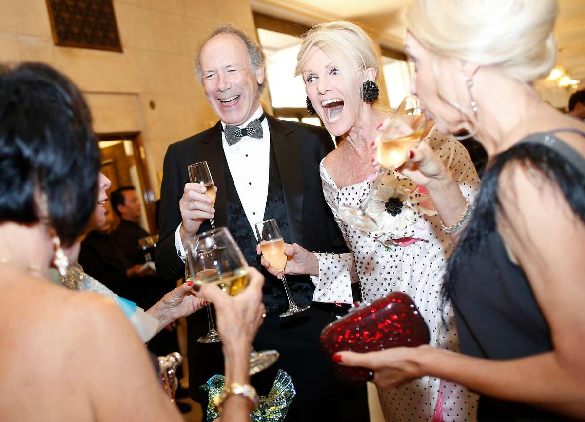 From center left: Thomas Barrett and Belinda Berry mingle during the 96th San Francisco Opera Ball at the War Memorial Opera House on Friday, Sept. 7, 2018, in San Francisco, Calif.