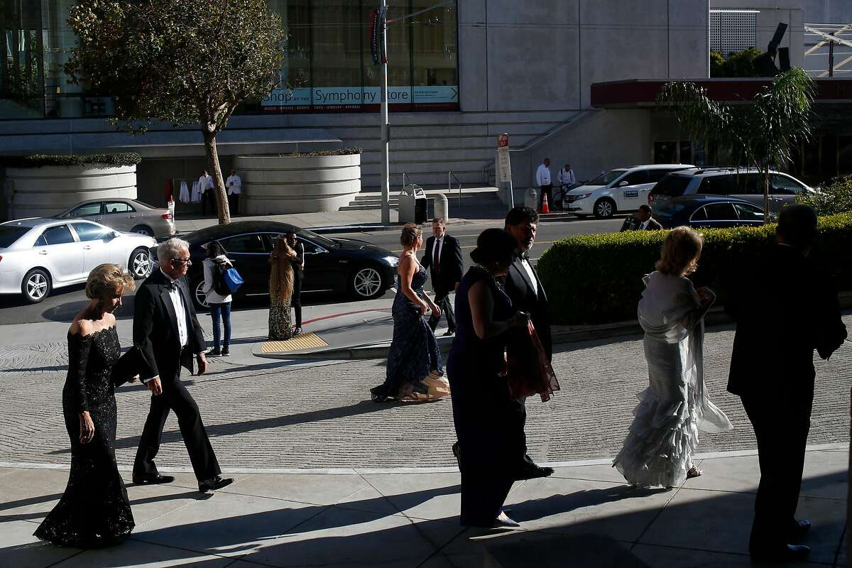 Guests make their way to the 96th San Francisco Opera Ball at the War Memorial Opera House on Friday, Sept. 7, 2018, in San Francisco, Calif.