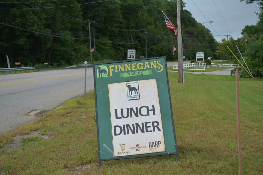 An advertisement for Finnegan's Tavern at the entrance to Burlington Commons plaza at 292 Spielman Highway Photo: Leslie Hutchison / Hearst Connecticut Media /