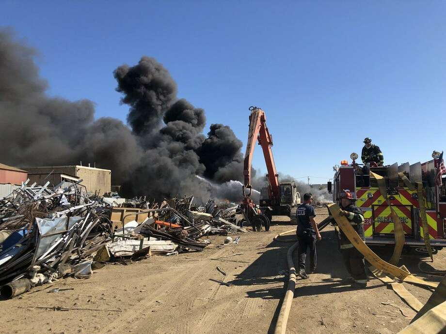 Alameda County Fire Department personnel battle a fire at Alco Iron & Metal headquarters near Davis Street and Doolittle in San Leandro around 4 p.m. on Friday, Sept. 7, 2018. Photo: Courtesy Of The Alameda County Fire Department