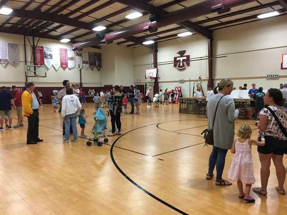 Indoors and out, the fun didn't stop at St. Mary's Fall Fest on Friday because of the persistent rain.