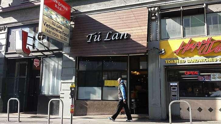 A pedestrian walks down Sixth Street in San Francisco where Carlos Argueta is accused of fatally stabbing James Thomas in 2015.