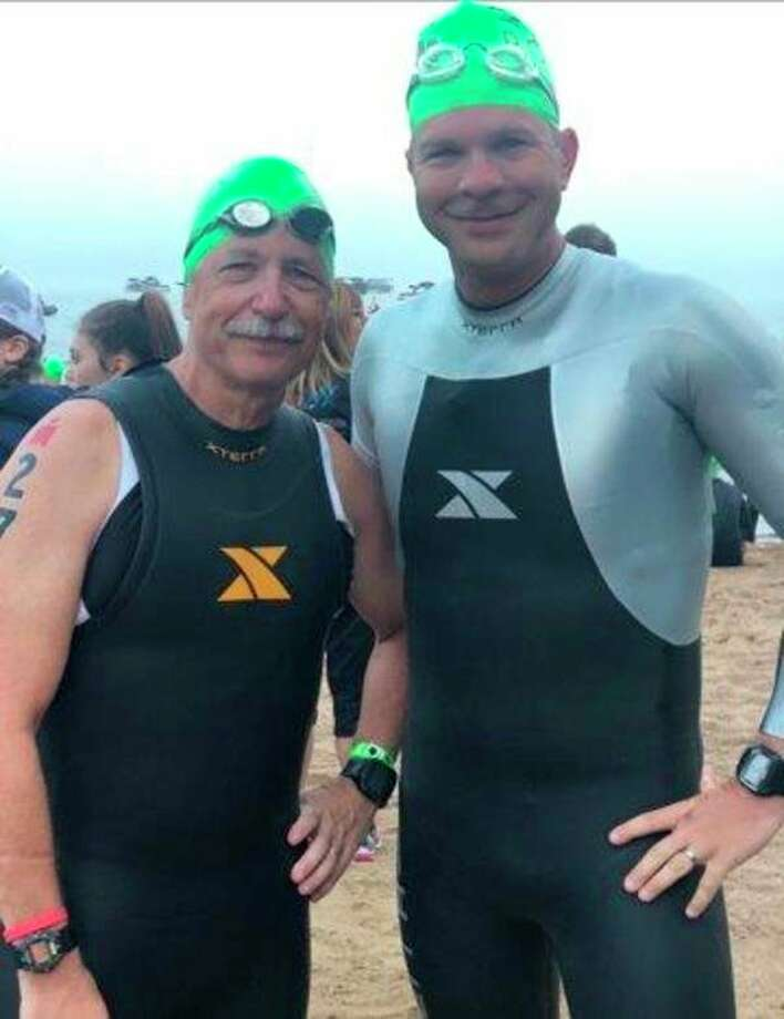 Midland's John Haag (left) and his son John Haag pose shortly before the start of the Mont-Tremblant Ironman triathlon in Quebec on Aug. 19. (photo provided)