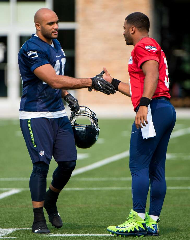 Austin Calitro of Danbury, left, with quarterback Russell Wilson at Seattle Seahawks minicamp in June of 2018. Photo: Photo Courtesy Of The Seattle Seahawks