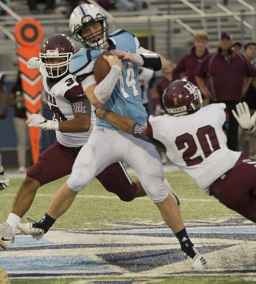 Greenwood's Weston Wilber tries to get away from Hereford's Xavier Gonzales and Jaden Cano 09/07/18 at J.M. King Memorial Stadium. Tim Fischer/Reporter-Telegram Photo: Tim Fischer/Midland Reporter-Telegram