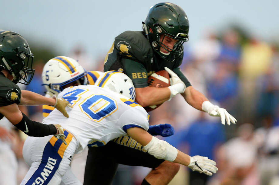 Legacy's Reid Rodgers is tackled by Kelly Catholic's Jude Mckinley.  Photo taken Friday 9/7/18  Ryan Pelham/The Enterprise Photo: Ryan Pelham, The Enterprise / ©2018 The Beaumont Enterprise
