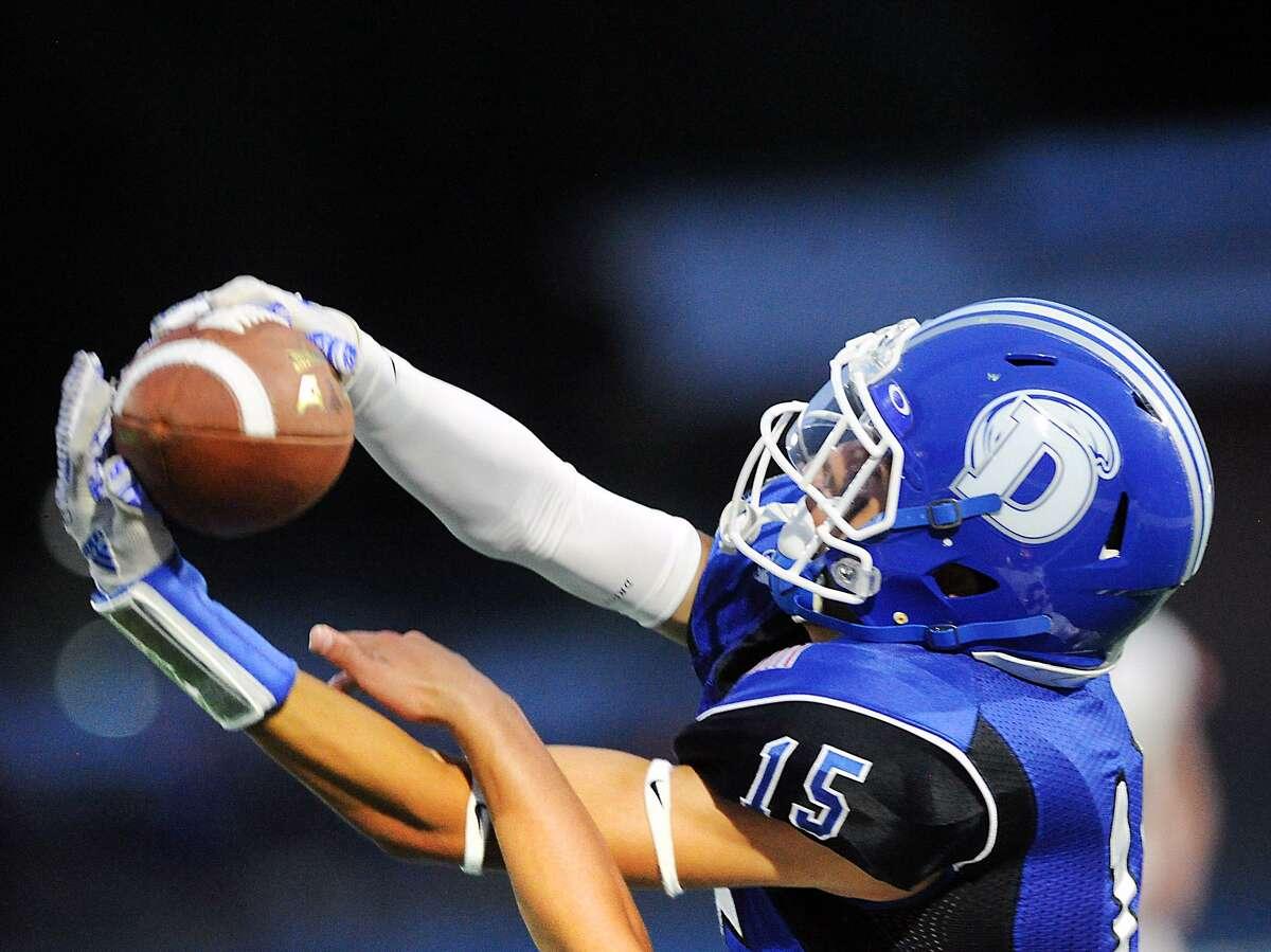 Darien receiver T.J. Cornacchia (#15) makes a reception durng the season opening high school football game between Darien High School and Ridgefield High School at Darien, Conn., Friday night, Sept. 7, 2018.
