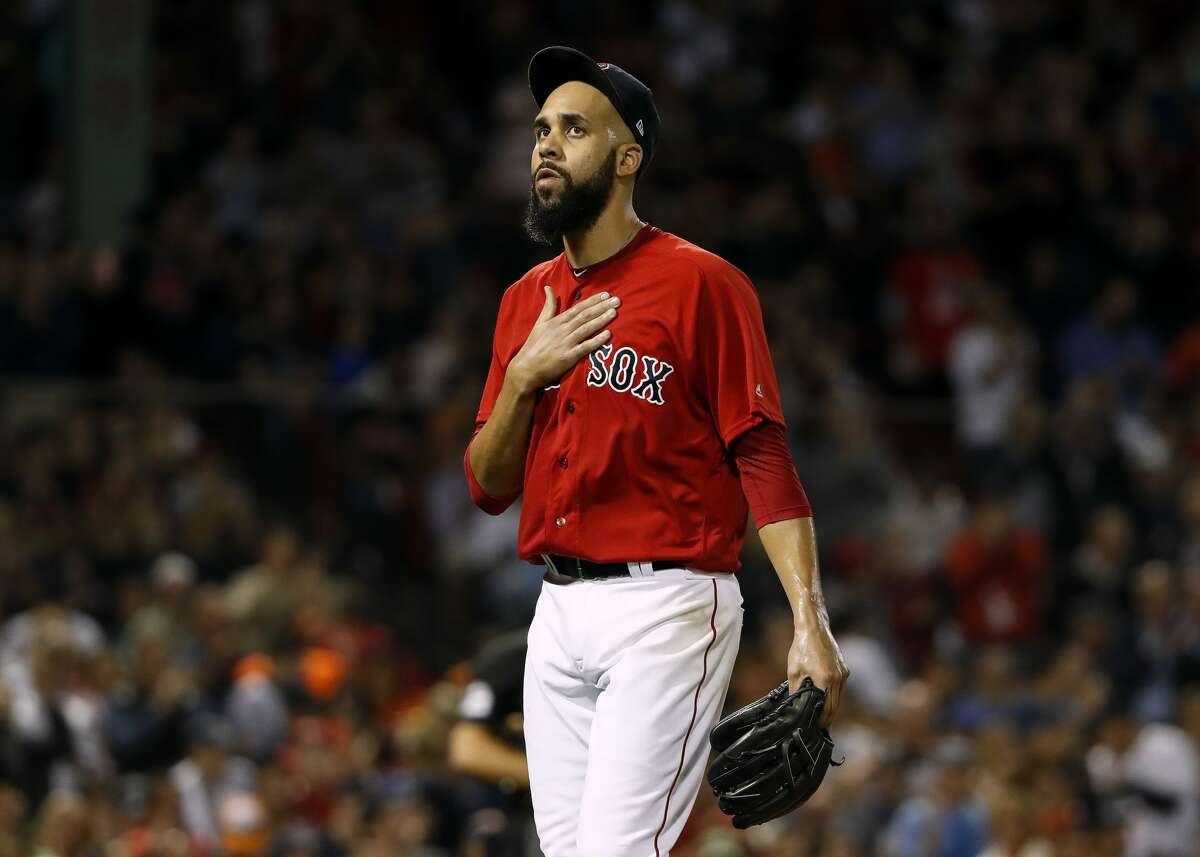 Boston Red Sox starting pitcher David Price gestures as fans cheer him after he was pulled from a baseball game during the seventh inning against the Houston Astros, Friday, Sept. 7, 2018, in Boston. (AP Photo/Winslow Townson)
