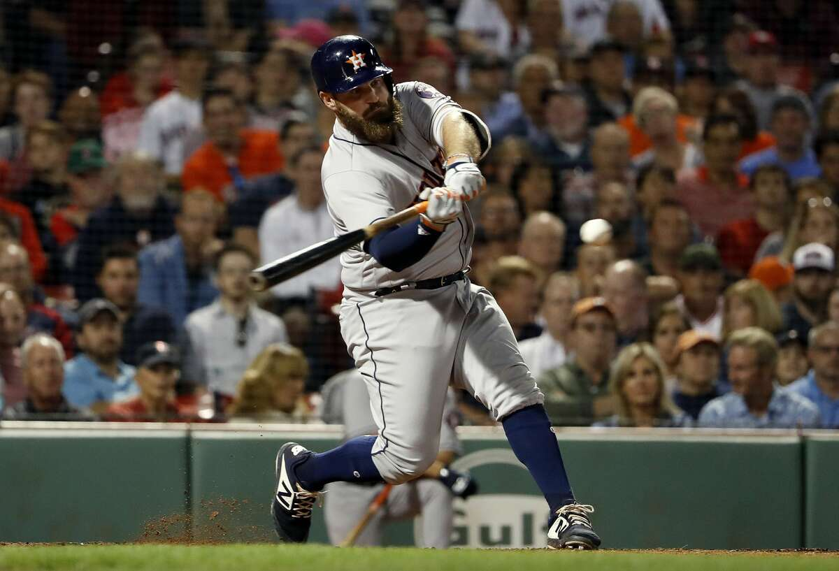 Houston Astros' Tyler White hits an RBI-single against the Boston Red Sox during the eighth inning of a baseball game Friday, Sept. 7, 2018, in Boston. (AP Photo/Winslow Townson)