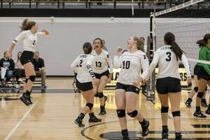 The Permian Panthers celebrate after a successful point against Monahans Friday night at Permian Field House.