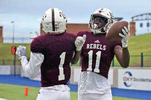 Lee's Loic Fouonji (11) celebrates with teammate Sheldon Bass (1) after scoring against Abilene Sept. 7, 2018, at Grande Communications Stadium. James Durbin/Reporter-Telegram