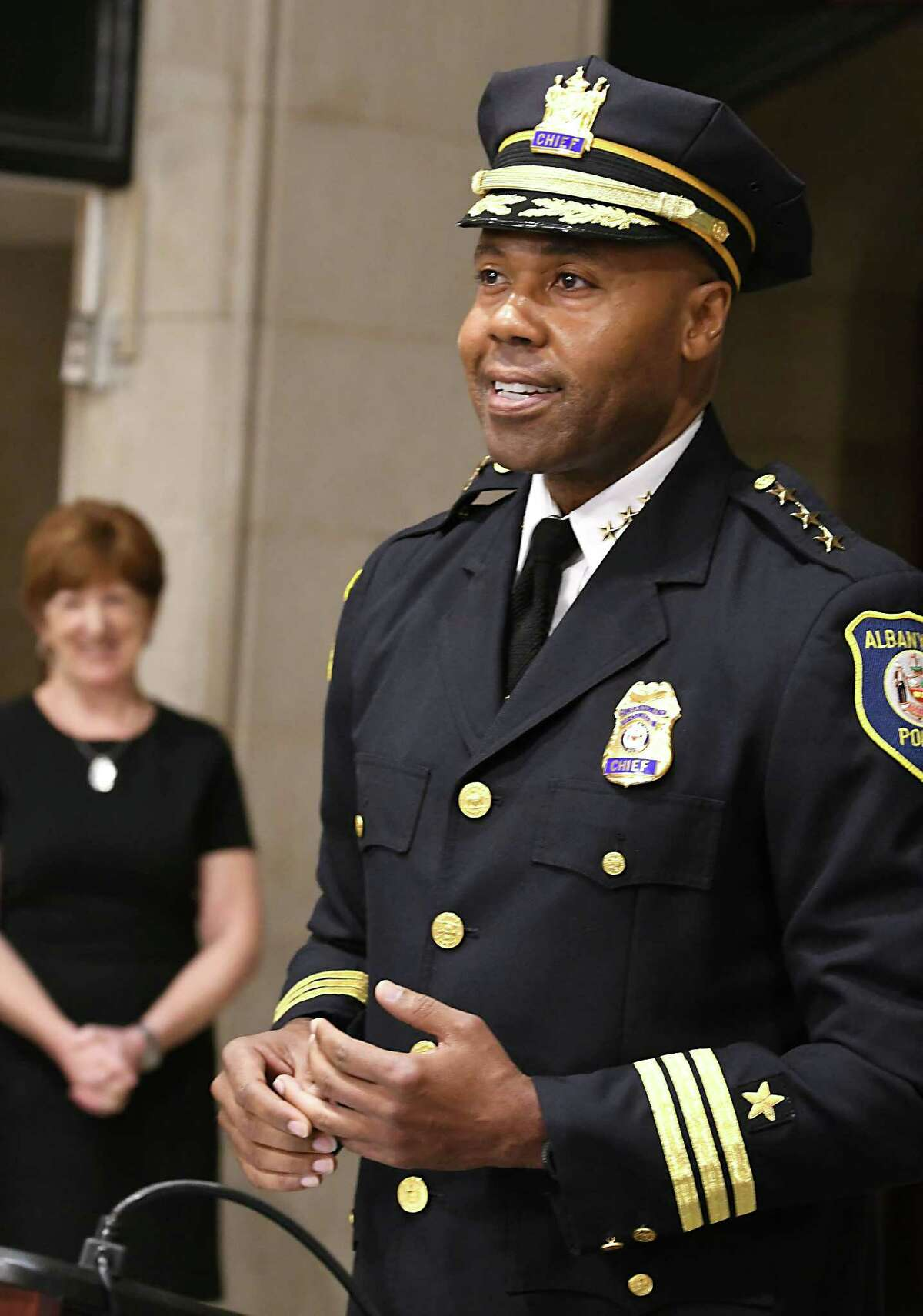 Albany Police Chief Eric Hawkins speaks after being sworn in by Albany Mayor Kathy Sheehan, left, at Albany City Hall on Friday, Sept. 7, 2018 in Albany, N.Y. Hawkins said the department is preparing to purchase drones. (Lori Van Buren/Times Union)