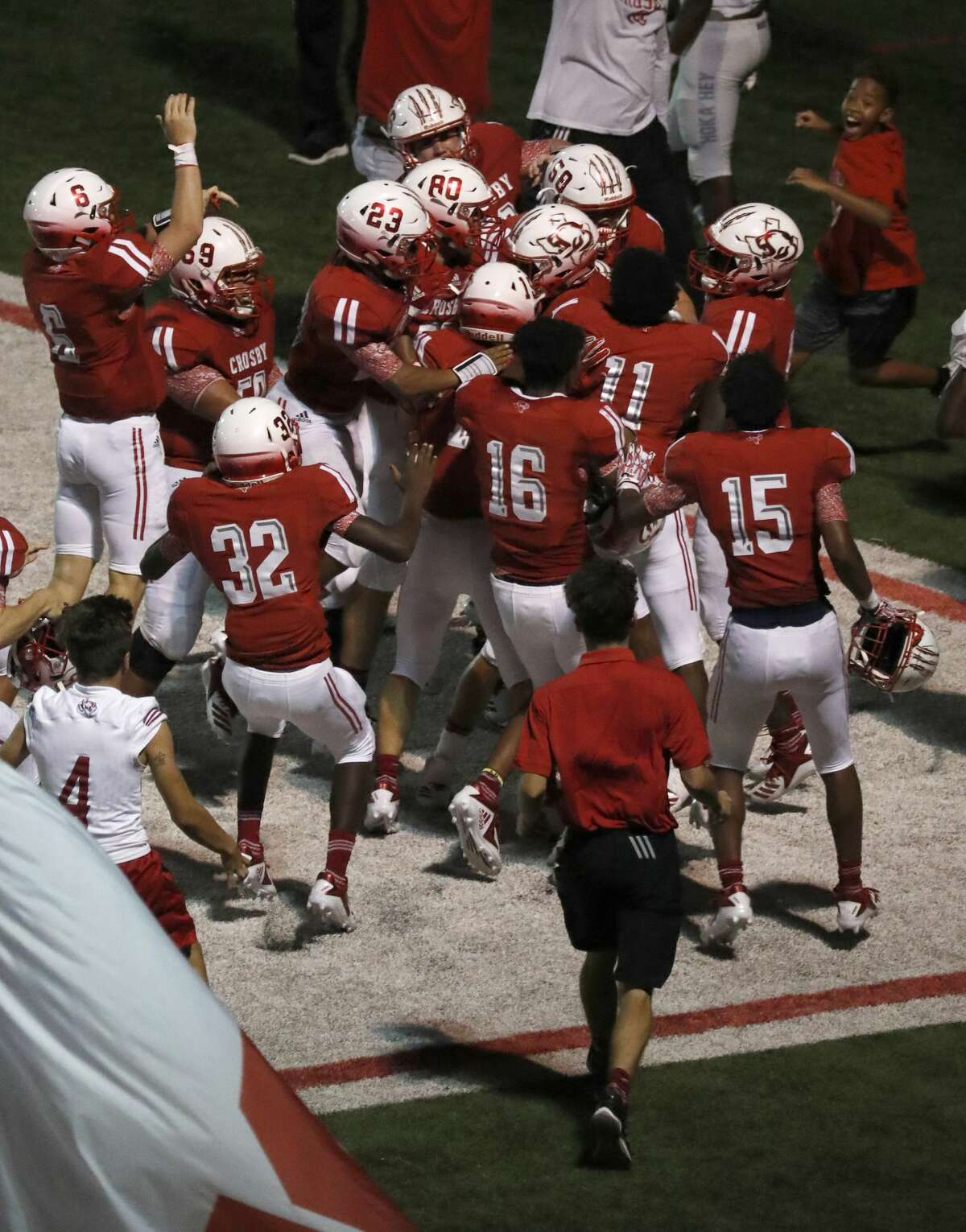 Crosby players storm the field after a last second touchdown to win 49-47 over Manvel during a high school football game at Cougar Stadium between Manvel and Crosby High Schools, Friday, September 7, 2018, in Crosby.