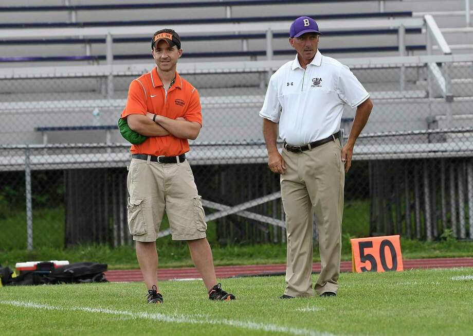 Bethlehem head coach John Carlino ,left, talks with Christian Brothers Academy head coach Joe Burke before a Section II Class AA High School football game Friday, Sept.7, 2018, in Colonie, N.Y. (Hans Pennink / Special to the Times Union) Photo: Hans Pennink / Hans Pennink