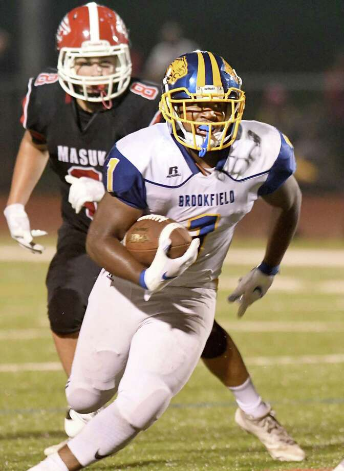 Brookfield's Nicholas Henderson runs the ball in for a touchdown during Friday's game against Masuk. Photo: Krista Benson / For Hearst Connecticut Media / The News-Times Freelance