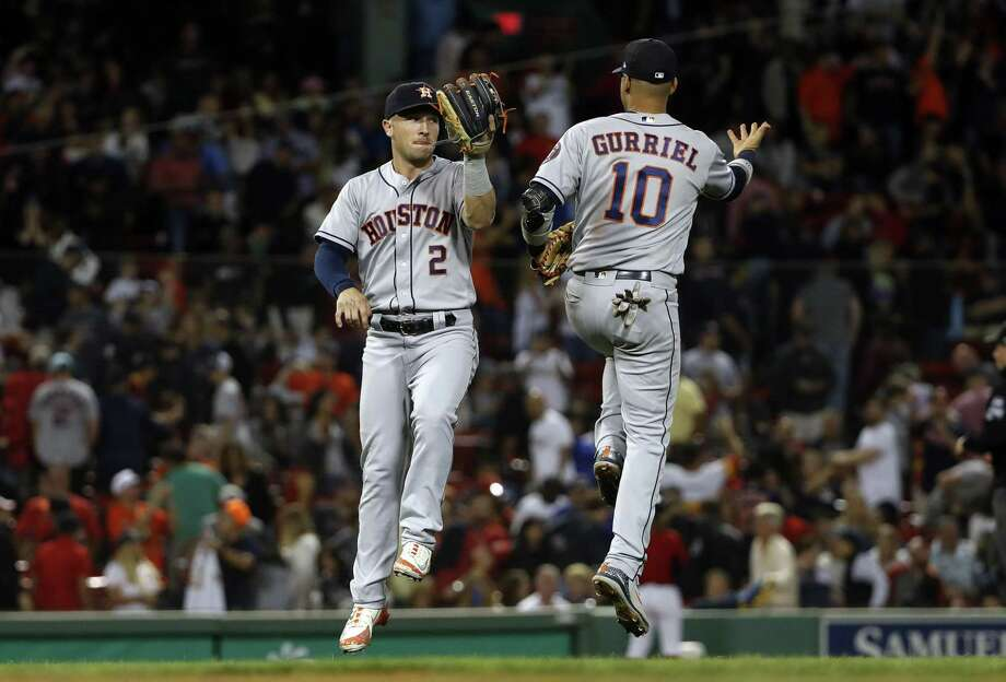 Houston Astros' Alex Bregman (2) and Yuli Gurriel celebrate after their win over the Boston Red Sox in a baseball game Friday, Sept. 7, 2018, in Boston. Photo: Winslow Townson, FRE / Associated Press / Copyright 2018 The Associated Press. All rights reserved.