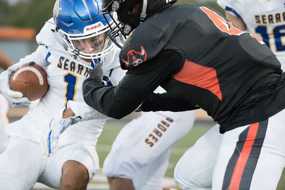 Serra High School's Terence Loville is tackled by Pittsburg High School's Josiah Porter on Friday, Sept. 7, 2018 in Pittsburg, CA. Photo: Paul Kuroda / Special To The Chronicle