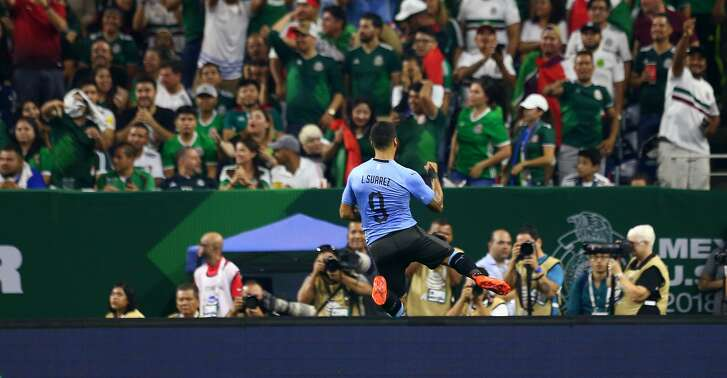 Uruguay forward Luis Suarez (9) celebrates his goal against the Mexico during the first half of an exhibition match at NRG Stadium Friday, Sept. 7, 2018, in Houston.