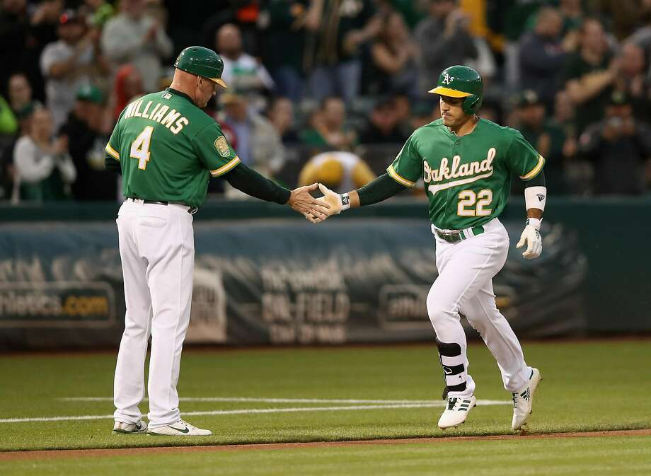 OAKLAND, CA - SEPTEMBER 07: Ramon Laureano #22 of the Oakland Athletics is congratulated by third base coach Matt Williams #4 after hitting a lead-off home run against Yovani Gallardo #49 of the Texas Rangers in the first inning at Oakland Alameda Coliseum on September 7, 2018 in Oakland, California. (Photo by Ezra Shaw/Getty Images) Photo: Ezra Shaw / Getty Images