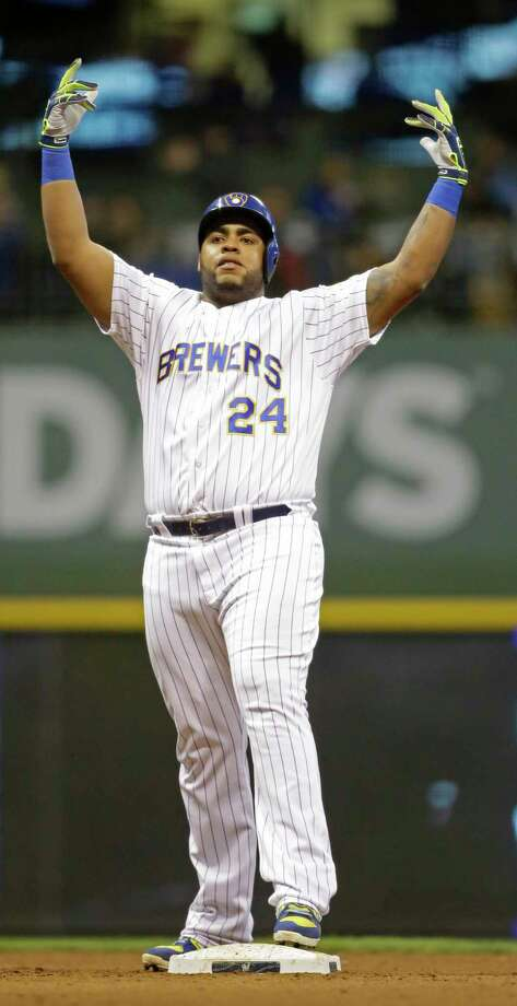 Milwaukee Brewers' Jesus Aguilar reacts after his two-RBI double against the San Francisco Giants during the seventh inning of a baseball game Friday, Sept. 7, 2018, in Milwaukee. (AP Photo/Jeffrey Phelps) Photo: Jeffrey Phelps / Copyright 2018 The Associated Press. All rights reserved.