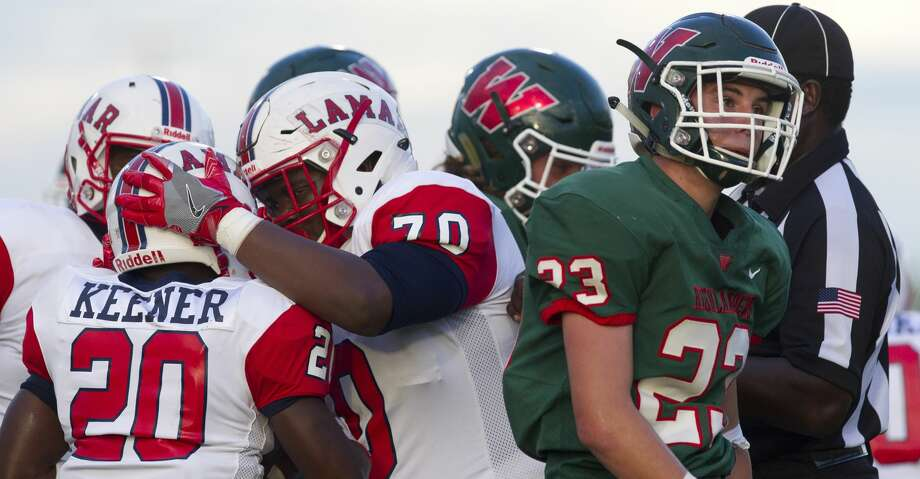 PHOTOS: High school football The Woodlands linebacker Orrin Binzer (23) reacts after a 1-yard touchdown by Lamar running back Cameron Keener (20) during the first quarter of a non-district high school football game at Woodforest Bank Stadium on Thursday, Sept. 6, 2018, in Shenandoah. Kenner's touchdown was set up by a kickoff fumble recovery by Lamar. Browse through the photos to see action from local high school football games on Sept. 7, 2018. Photo: Jason Fochtman/Staff Photographer