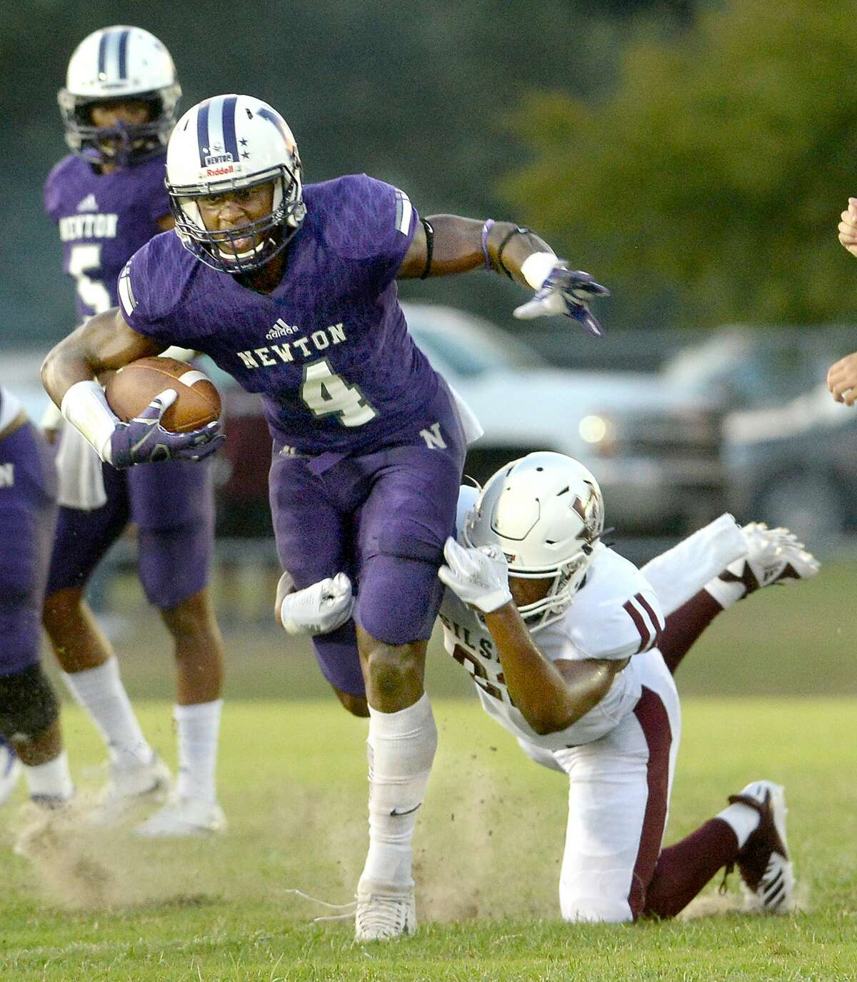 Newton's Darwin Barlow breaks away from Silsbee's Aaron Sells during their non-district match-up Friday at Newton High School. Friday, September 07, 2018 Kim Brent/The Enterprise
