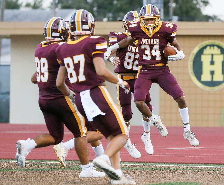 Harlandale's Mycheal Humphrey (right) celebrates his 86-yard kickoff return on the opening kickoff with teammates during their high school football game with South San at Harlandale Memorial Stadium on Fiday, Sept. 7, 2018. Photo: Marvin Pfeiffer, Staff / San Antonio Express-News / Express-News 2018