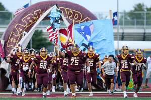 The Harlandale Indians take the field at the start of their high school football game with South San at Harlandale Memorial Stadium on Friday, Sept. 7, 2018. Harlandale beat South San 17-7.