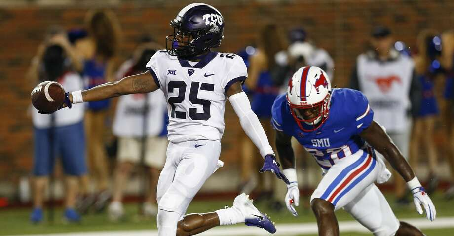 TCU wide receiver KaVontae Turpin (25) runs for a touchdown after a catch past SMU linebacker Jimmy Phillips Jr. (24) during the fourth quarter of an NCAA college football game Friday, Sept. 7, 2018, in Dallas. TCU won 42-12. (AP Photo/Jim Cowsert) Photo: Jim Cowsert/Associated Press