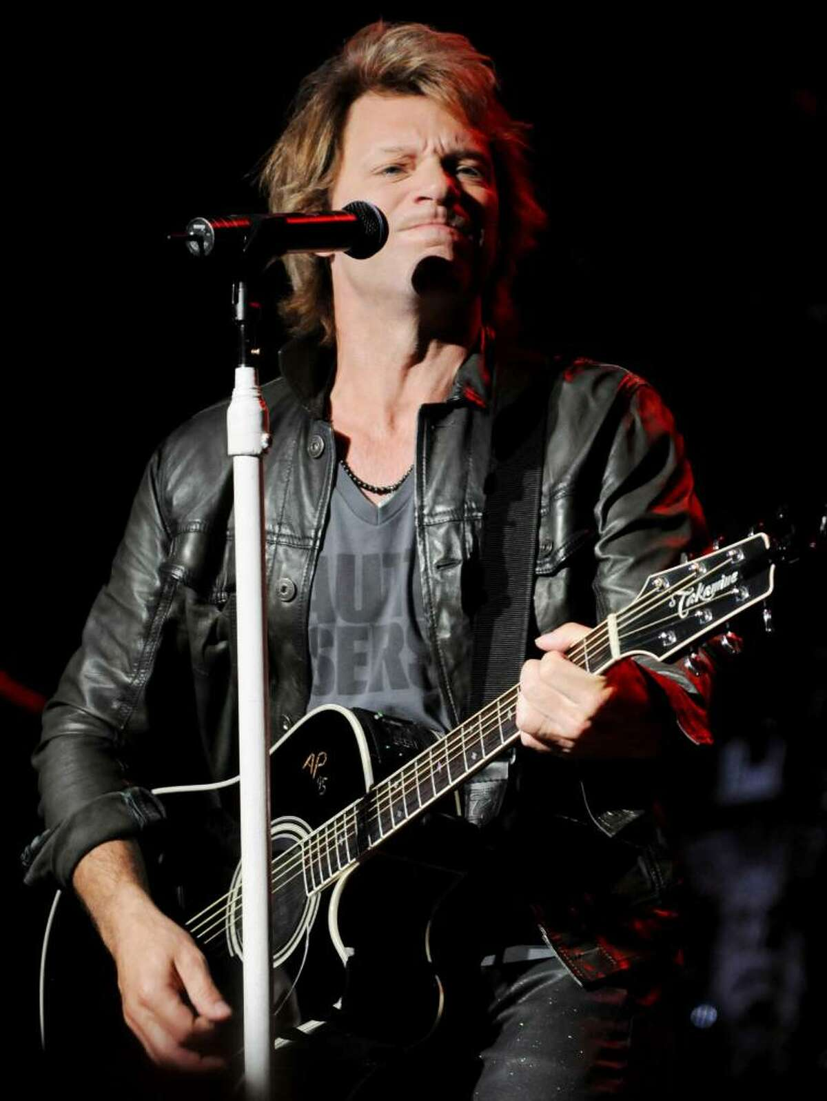 Headliner Jon Bon Jovi performs on stage at SPAC, on Sunday, July 11, 2010, Saratoga Springs, NY, before a sold out amphitheater, and huge lawn crowd.