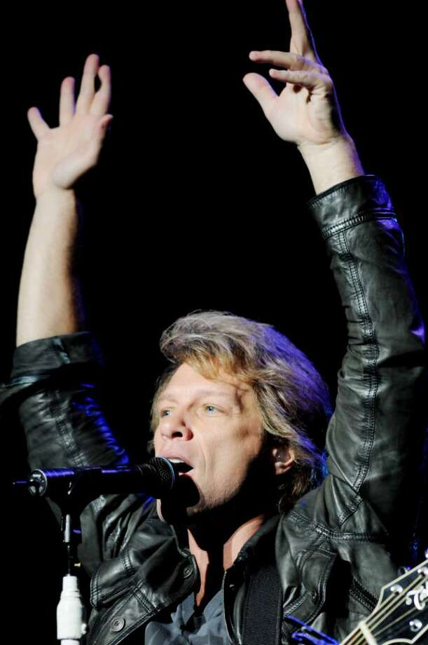 Headliner Jon Bon Jovi performs on stage at SPAC, on Sunday, July 11, 2010, Saratoga Springs, NY, before a sold out amphitheater, and huge lawn crowd.         (Luanne M. Ferris / Times Union) Photo: LMF