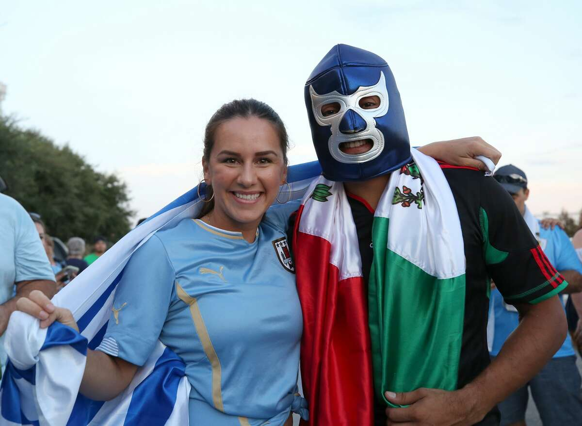 Soccer fans pose for a photograph prior to the match between Mexico and Uruguay at NRG Stadium Friday, Sept. 7, 2018, in Houston.