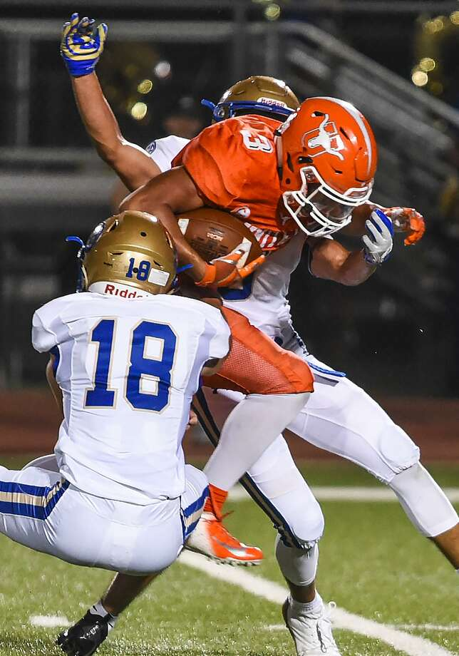 United High School Jerry Gonzalez pushes through the defense during a game against Alamo Heights High School on Friday, Sept. 7, 2018, at the Bill Johnson Student Activity Complex. Photo: Danny Zaragoza /Laredo Morning Times File