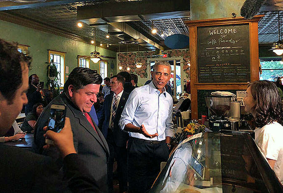 Former President Barack Obama makes a campaign stop at Caffe Paradiso in Urbana on Friday. He made a campaign stop with Democratic gubernatorial candidate J.B. Pritzker (left) following his speech at the University of Illinois. Sara Burnett | AP