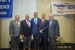 University of Connecticut Football Coach Randy Edsall spoke at a Middlesex County Chamber of Commerce member breakfast Aug. 22. From left are Chairman Jay Polke, Vice Chairman Don DeVivo, Edsall, Peoples United Bank for Northern Connecticut President Michael J. Casparino and Chamber President Larry McHugh.