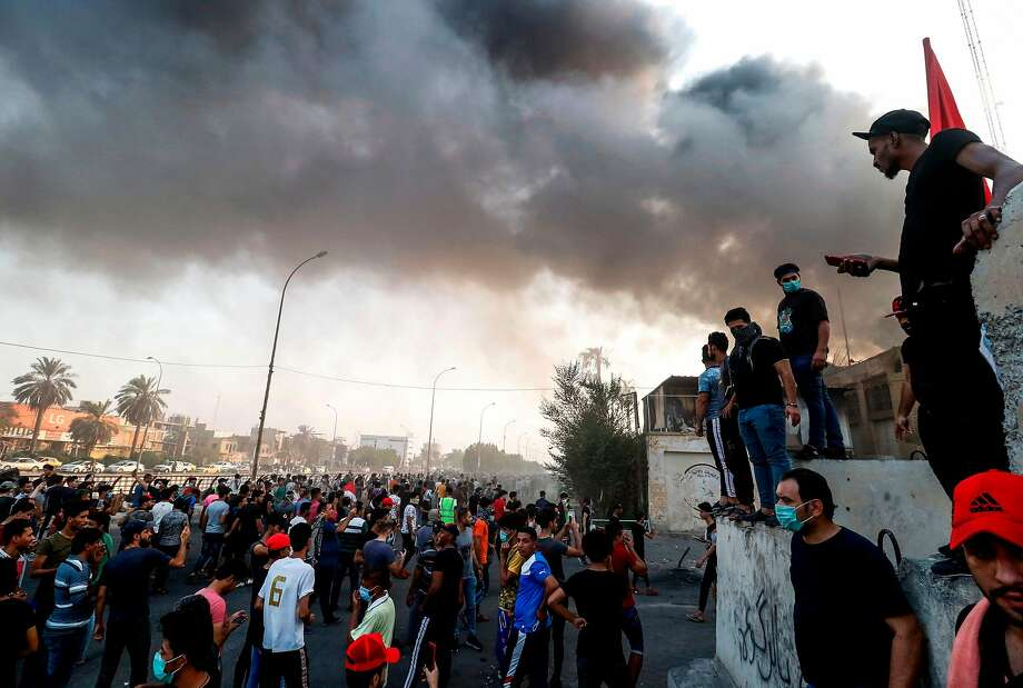 Iraqi protesters gather outside the burnt-down local government headquarters in the southern city of Basra on September 7, 2018 during demonstrations over poor public services. - Basra has seen a surge in protests since September 4, with demonstrators torching government buildings as well as political party and militia offices, as anger boils over after the hospitalisation of 30,000 people who had drunk polluted water. (Photo by Haidar MOHAMMED ALI / AFP)HAIDAR MOHAMMED ALI/AFP/Getty Images Photo: HAIDAR MOHAMMED ALI;Haidar Mohammed Ali / AFP / Getty Images