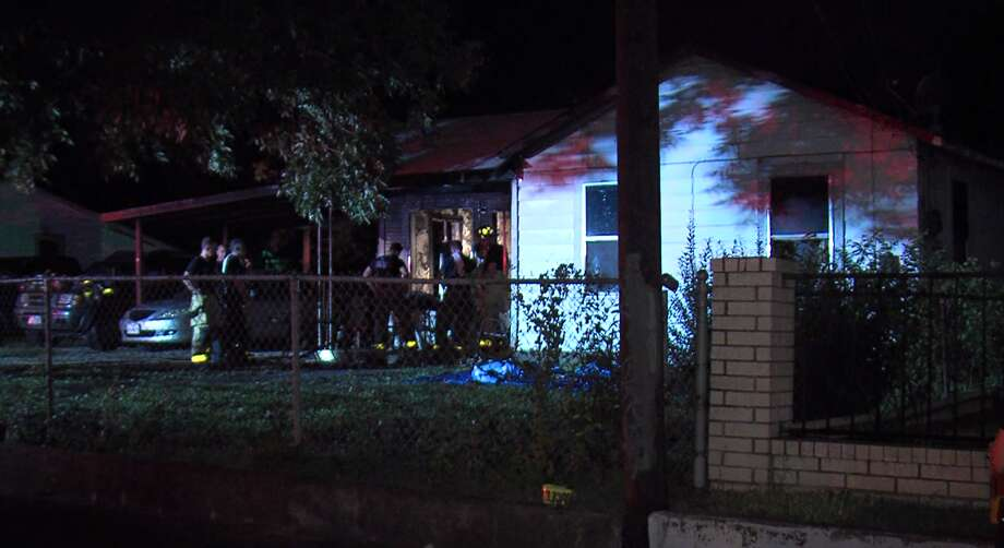 Firefighters responded about 11:20 p.m. to the 1700 block of Madrid Street where they found two people trapped. Photo: J.J. Trevino / 21 Pro Video