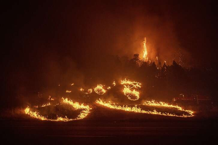 Flames from a backfire burn a hillside as fire fighters battle the Delta Fire in the Shasta-Trinity National Forest, Calif., on Thursday, Sept. 6, 2018. (AP Photo/Noah Berger)