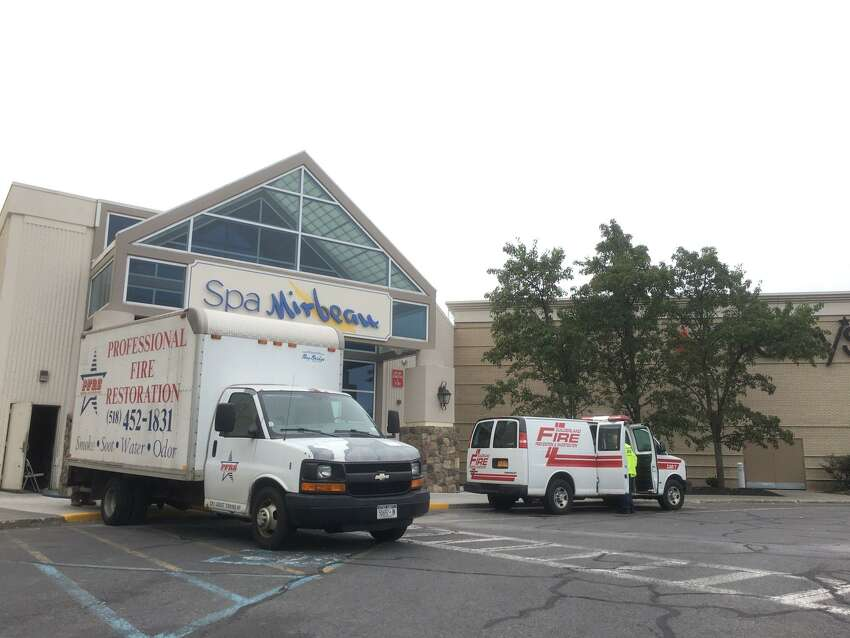 Fire personnel and a restoration crew vehicles were at Spa Mirbeau at Crossgates Mall Saturday, Sept. 8, 2018, following an early morning fire in the laundry room.