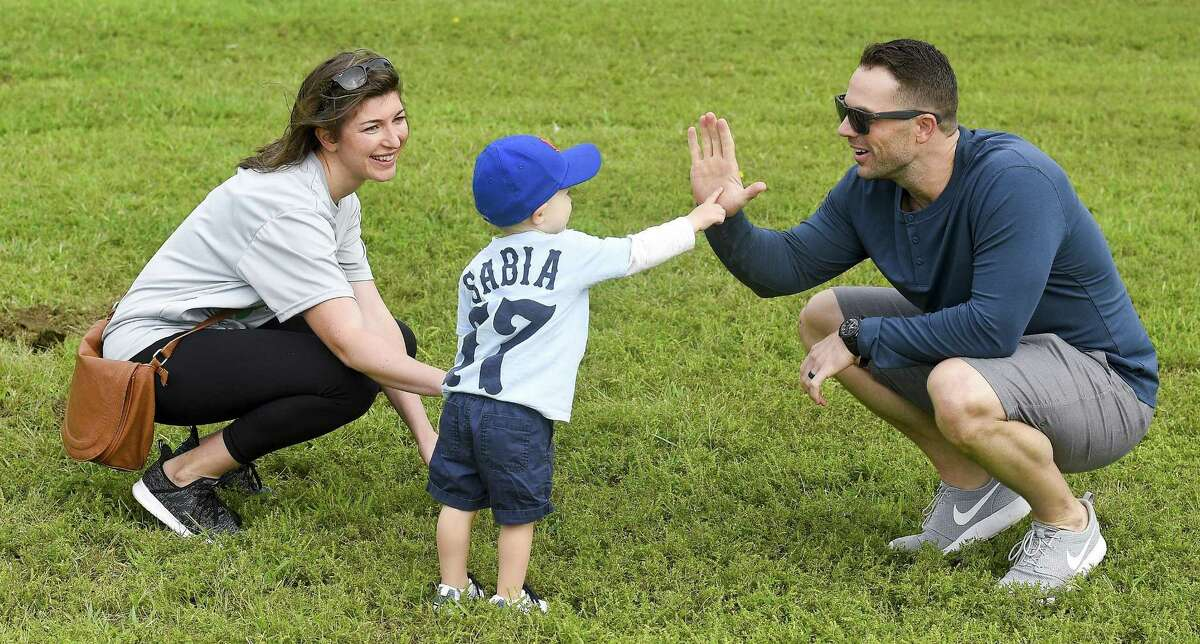 """New York Mets third baseman David Wright, at right, shares a high-five with CJ Sabia and Emma, Chris Sabia's wife, as teams compete during the inaugural Christopher Sabia Memorial Wiffle Ball Tournament at Cove Island Park in Stamford on Saturday, Sept. 8, 2018.""""Sabes"""" was a Stamford Legion baseball executive, coach and player for over two decades before he passed away from cancer last July at age 39. He was survived by his wife Emma and son CJ."""
