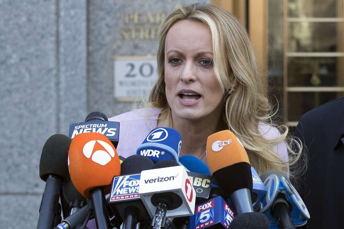 In this Monday, April 16, 2018 file photo adult film actress Stormy Daniels speaks outside federal court in New York. The company set up by Donald Trump's former personal attorney has agreed to rescind Daniels' hush-money agreement and drop its planned $20 million lawsuit against the porn actress for violating the agreement.