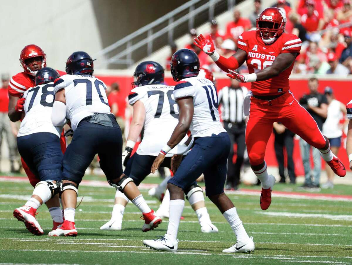 Houston Cougars linebacker Roman Brown (20) leaps up after Arizona Wildcats quarterback Khalil Tate got off a pass during the first half of a college football game at TDECU Stadium, Saturday, September 8, 2018, in Houston.