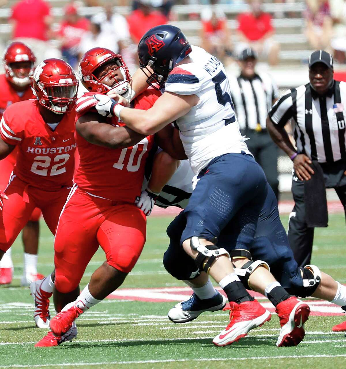 Houston Cougars defensive tackle Ed Oliver (10) works against Arizona Wildcats offensive lineman Josh McCauley (50) during the first half of a college football game at TDECU Stadium, Saturday, September 8, 2018, in Houston.