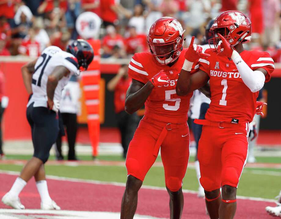 Houston Cougars Bryson Smith (1) celebrates his touchdown with Marquez Stevenson (5) during the first half of a college football game at TDECU Stadium, Saturday, September 8, 2018, in Houston. Photo: Karen Warren, Staff Photographer / © 2018 Houston Chronicle