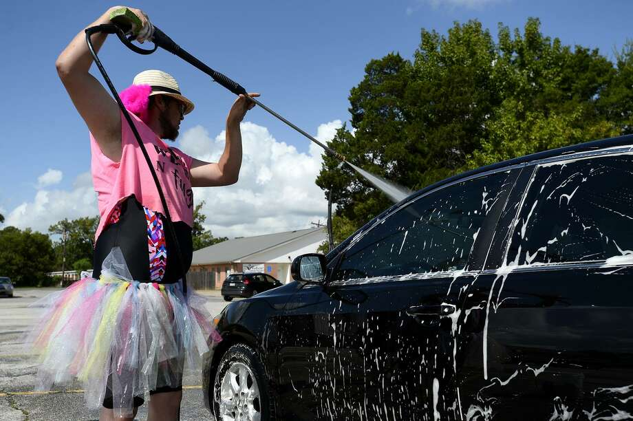 Jimmy Leatherwood sports a colorful tutu during a benefit car wash hosted by The Dumb, Weird 'n Fugly in Vidor on Saturday. The group was raising money for member Nick Strother, who had a kidney removed due to cancer.   Photo taken Saturday 9/8/18  Ryan Pelham/The Enterprise Photo: Ryan Pelham / The Enterprise / ©2018 The Beaumont Enterprise