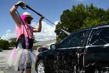 Jimmy Leatherwood sports a colorful tutu during a benefit car wash hosted by The Dumb, Weird 'n Fugly in Vidor on Saturday. The group was raising money for member Nick Strother, who had a kidney removed due to cancer. Photo taken Saturday 9/8/18 Ryan Pelham/The Enterprise