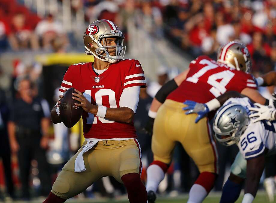 FILE - In this Aug. 9, 2018, file photo, San Francisco 49ers quarterback Jimmy Garoppolo looks for a receiver during the team's NFL preseason football game against the Dallas Cowboys in Santa Clara, Calif. The Niners acquired Garoppolo before the trade deadline from New England. After a few weeks to learn the offense, Garoppolo stepped in and showed why the Patriots had groomed him as Tom Brady's successor. (AP Photo/Josie Lepe, File) Photo: Josie Lepe / Associated Press
