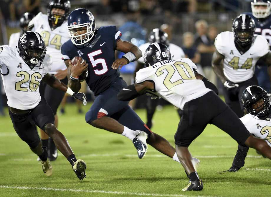 UConn quarterback David Pindell (5) runs the ball in for a touchdown against Central Florida during their season opener. Photo: Stephen Dunn / Associated Press / Copyright 2018 The Associated Press. All rights reserved